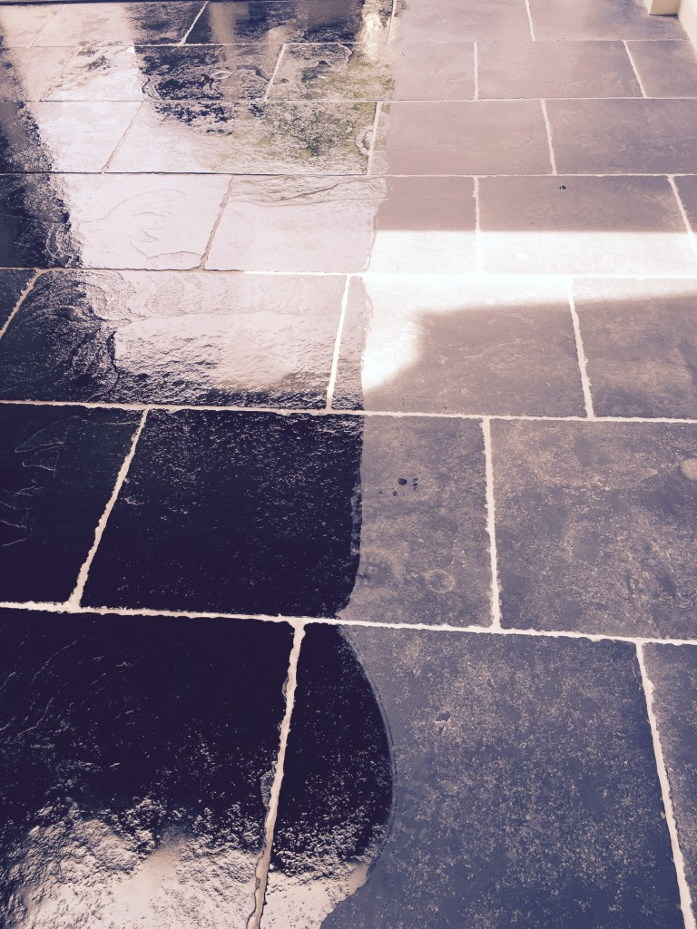 Black Limestone Tile Adding Stone Oil in Wimbledon