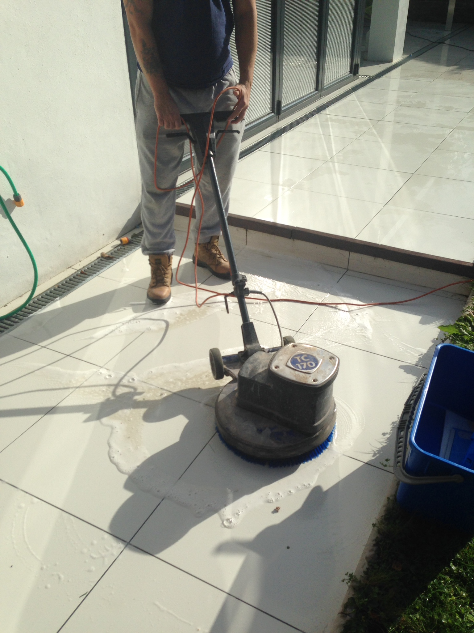 Applying ant slip to a shiny porcelain patio east surrey tile doctor applying anti slip to shiny slippery porcelain tiles in ashtead33 dailygadgetfo Image collections