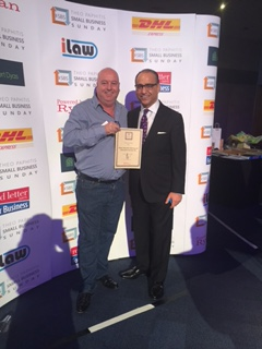 Theo Paphitis presents Bill Bailey with a Small Business Sunday award.