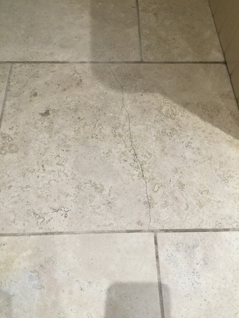 Renovating travertine kitchen floor tiles in sanderstead tile travertine kitchen floor cracked tile before repair sanderstead dailygadgetfo Image collections